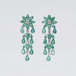 Pair of opulent emerald and diamond earrings
