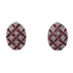Pair of ear plugs in the Art Deco style with rubies among diamonds