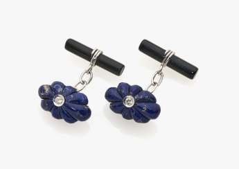 A pair of cufflinks with diamonds, lapis lazuli and onyx