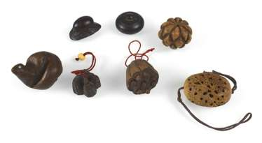 Seven Netsuke and Toggles, wooden, inter alia, in the Form of a Lotus Bud