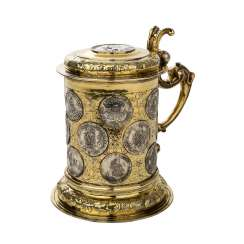 Attractive coin TANKARD with a total of 16 coins and 2 medals worked.