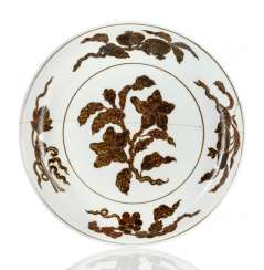 Unusual dish with a decoration of flower branches in iron-brown