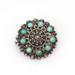 Brooch with turquoise.