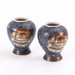 Pair of porcelain vases with picture cartouches