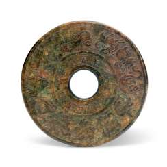A CHINESE MOTTLED GREEN AND RUSSET JADE 'ZODIAC' DISC, BI