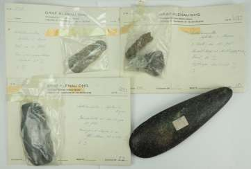 Collection of stone wedges and amulets.