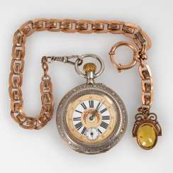 Decorative pocket watch with watch chain.