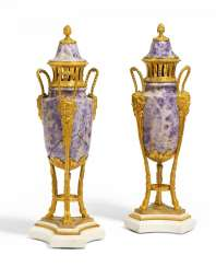 Pair of ornamental vases with Maskarons