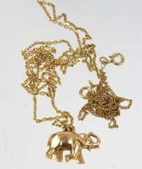 Elephant pendant, among other things, - yellow gold 333