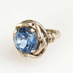 Ring with light blue synthesis.