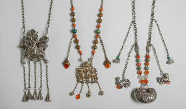 Three silver chains with figurative and zoomorphic jewelry