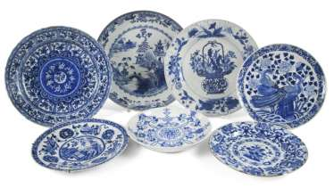 Seven porcelain plates with underglaze blue decoration, including peacocks