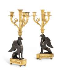 A PAIR OF FRENCH ORMOLU AND PATINATED-BRONZE FOUR-LIGHT 'CANDELABRES AU GRIFFON'