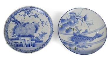 Two large porcelain circular plates with blue-and-white fish - and flowers decor
