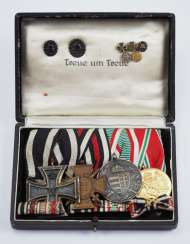 Medalbar with 4 decorations, in a case.