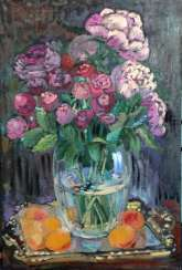 Roses and peonies in glass vase.