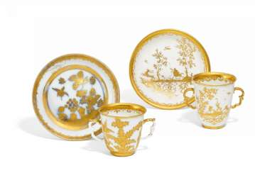 Two double handle cups and bowls with gold Chinese
