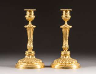 PAIR OF CEREMONIAL CANDLESTICKS, IN LOUIS XVI STYLE