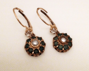 Earrings with diamonds emeralds and pearls