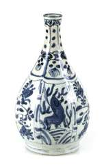 Under glaze blue decorated Kraak bottle vase with horses and flowers