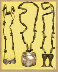 Extensive group of jewelry, including necklaces and pendants, some with coral and shells