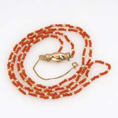 Coral necklace with decorative be