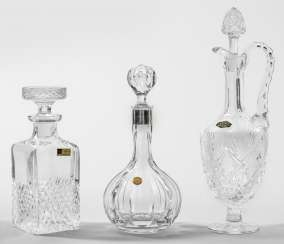 Three carafes with stoppers