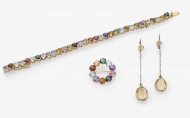 BRACELET, BROOCH AND A PAIR OF DROP EARRINGS WITH COLORED STONES . 1970-1980s