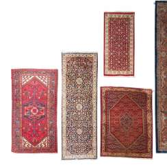 Four Oriental Rugs, 20th. Century.
