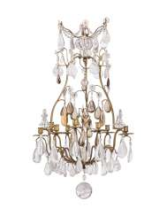 A FRENCH GILT-METAL, CLEAR AND AMBER ROCK CRYSTAL NINE-LIGHT CHANDELIER