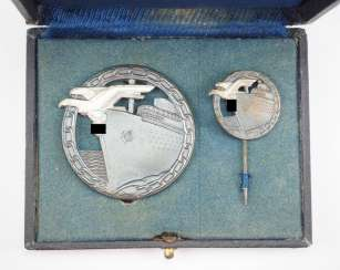 Blockade runners war badge, with miniature, in a case.