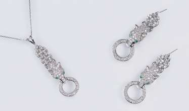 Pair of diamond and emerald earrings 'Panther' with matching pendant on a chain