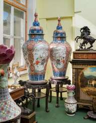 A PAIR OF LARGE JAPANESE IMARI VASES AND COVERS, ON STANDS
