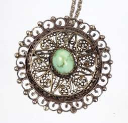 Pendant with turquoise on a chain