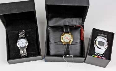 3 mens wrist watches in a case