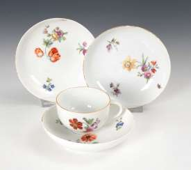 Cup and 3 saucers with flowers painter