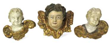 THREE WINGED PUTTI HEADS,