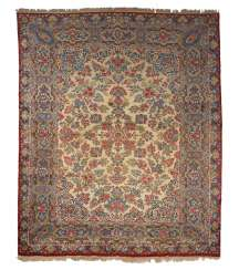 A large Oriental rug with colorful Blumenb