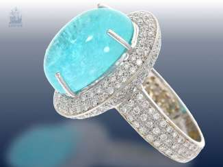 Ring: very valuable and elaborately crafted gold ring forging with an exceptionally large Paraiba tourmaline and fine diamond trimming