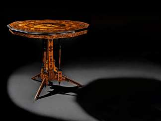 AN ITALIAN PENWORK, INTARSIA, EBONY AND STAINED FRUITWOOD MARQUETRY CENTRE-TABLE