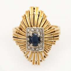 Ladies ring with sapphire and diamonds,