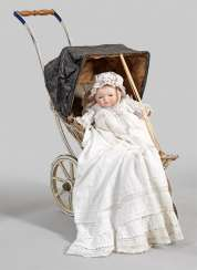 Bye-Lo Baby by Grace Storey Putnam with a doll cart