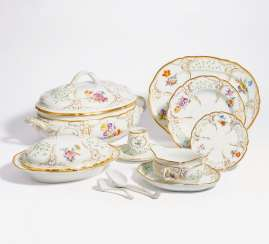 Large dinner service with floral decoration