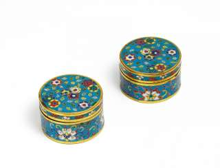 Pair of small round cans with Lotus
