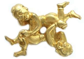 Gold plated brush metal shelf in the Form of two boys