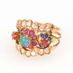 Harem ring with Opal triplet, rubies and sapphires.