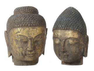 2 Buddha heads, Southeast Asia, stone, gold-plated, the head of a Buddha with eyes lowered and long earlobes, H