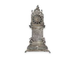 Desk clock: an extremely decorative repoussé technology table clock in the Rococo style, silver, spindle work of Breguet, signed, CA. 1800