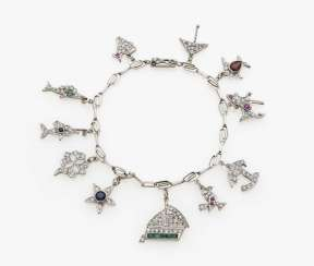 Charming bracelet with diamonds, sapphires, emeralds and rubies