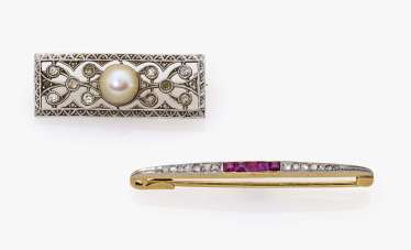 Two brooches with diamonds, rubies and cultured pearl Germany, around 1915-1920